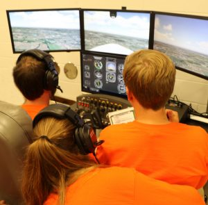 Students with flight simulator